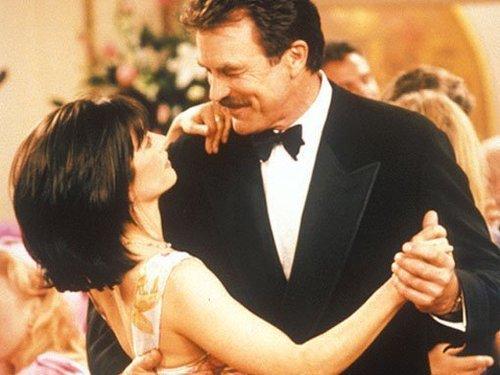 monica and richard dancing at a wedding